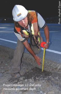 Project Manager J.J. DeCorby measures pavement depth